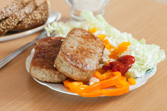 Cutlets with lettuce Stock Photo