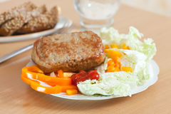 Cutlets with lettuce Stock Images