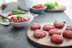 Cutlets made from forcemeat. On wooden board Stock Photography
