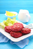 Cutlets of meat and beetroot Stock Image