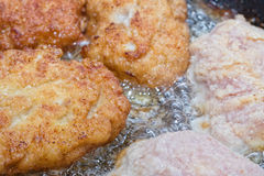 Cutlets from minced meat fried in a pan Royalty Free Stock Image
