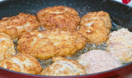 Cutlets from minced meat fried in a pan Stock Photo