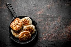 Cutlets in pan royalty free stock photography