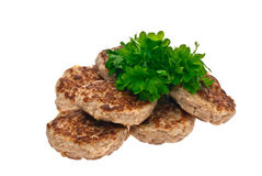 Cutlets, parsley, white background, isolated Royalty Free Stock Photos