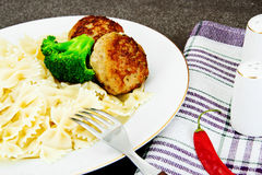 Cutlets with Pasta and Broccoli. Studio Photo Royalty Free Stock Images