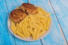 cutlets with pasta on a plate stock image