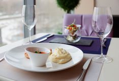 Cutlets, potato mash and vegetable salad on restaurant table Stock Photo