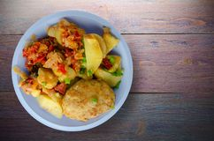 Cutlets with potatoes and stewed tomatoes. Stock Photos