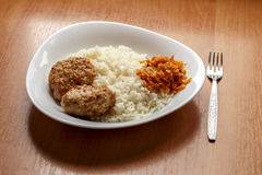 Cutlets,rice,stewed cabbage stock photos