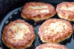 Cutlets are roasted in an black frying pan stock photography