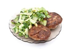 Cutlets with salad Stock Photos
