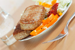 Cutlets with salad Stock Image