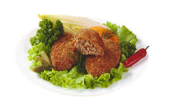 Cutlets on salad leaves Stock Photo