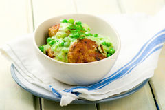 Cutlets with sauce from peas Stock Images