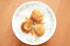Cutlets with slices of carrots Royalty Free Stock Photography