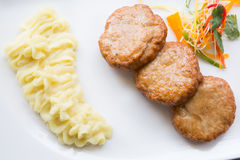 Cutlets with smashed potatoes. Meat cutlets with smashed potatoes on a white plate Stock Photography
