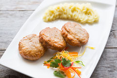 Cutlets with smashed potatoes. Meat cutlets with smashed potatoes on a white plate Stock Images
