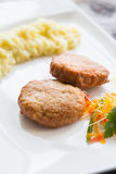 Cutlets with smashed potatoes. Meat cutlets with smashed potatoes on a white plate Royalty Free Stock Photo