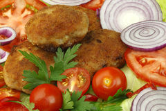 Cutlets and vegetables Royalty Free Stock Images