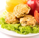 Cutlets and vegetables. Background colored stock photo