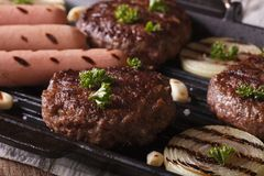Cutlets with vegetables on a grill pan closeup. horizontal Stock Photography