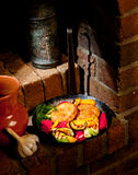 Cutlets and vegetables grilled on an iron skillet royalty free stock photos