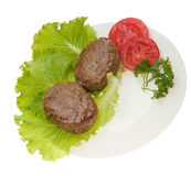 Cutlets with vegetables on a plate Royalty Free Stock Photo