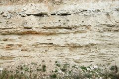 Sandstone layers of Earth epochs. A cutoff of the ground of the Earth with sandstone. We can layers of different age and density royalty free stock photo