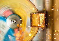 Cutoff wheel in action. Working cutoff wheel with multitude of sparks royalty free stock images