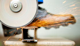 Cutoff wheel in action. Working cutoff wheel with multitude of sparks stock photos