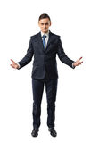 Cutout business guy raised his hands mimicking shape of something big. Stock Image