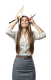 Cutout businesswoman in stress holding keeps office supplies over the head. Stock Images