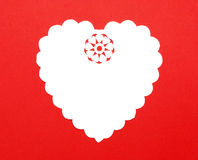 Cutout Fancy Paper Heart Doily. Handmade Cutout Fancy Paper Heart Doily isolated on red background Royalty Free Stock Images