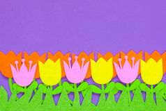 Brightly colored felt tulip flowers on a plain background stock illustration