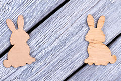 Cutout figurines of bunnies. Plywood Easter rabbits. Cutout figurines of bunnies. Animalistic decorative items stock photography