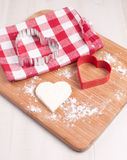 Cutout heart cookie from dough Royalty Free Stock Photo