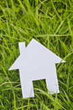 Cutout House on Green Grass Stock Photo
