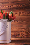 Cutout image of a flowers box with orange tulips Stock Image