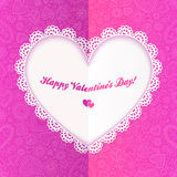Cutout lacy paper heart on pink ornate background Royalty Free Stock Photo