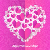 Cutout lacy paper heart on pink ornate background Royalty Free Stock Photography