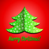 Cutout paper Christmas tree with snowflakes Royalty Free Stock Image