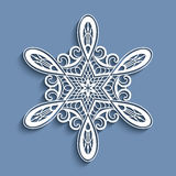 Cutout paper lace snowflake, crochet ornament Royalty Free Stock Photography