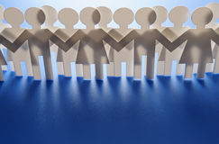Cutout people. Horizontal image of cutout paper people royalty free stock photo