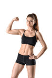 Cutout portrait of young strong muscular woman flexing her biceps Royalty Free Stock Photography