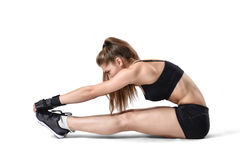 Cutout woman doing stretching workout in training dress, focus on hands. Royalty Free Stock Photo