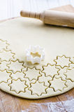 Cutouts of cookie dough. On the wooden board Stock Photography