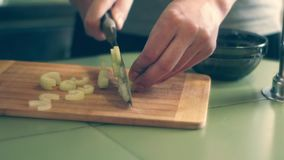 Cuts celery with a knife. Slice the celery with a knife male hand home cooking stock video