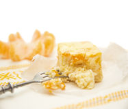 Cuts of cheese cake with mandarin on white background Royalty Free Stock Image