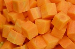 Cuts cubes of carrot. detail royalty free stock image