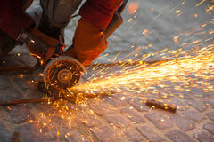 Cuts metal. Angular grinding machine cuts metal with sparks Stock Images